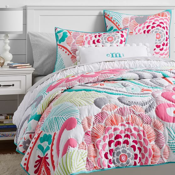 Bedroom With A Colorful Bed Cover