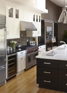Black kitchen counters and backsplash