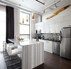 Cool Modern Loft Kitchen with white marble kitchen island