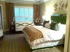 Green bed with green headboard
