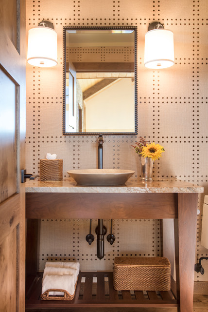 Powder room in denver with vessel sink and cabinets