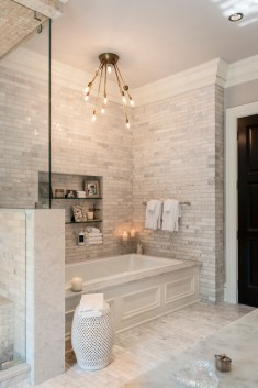 Transitional master bathroom by Tabberson Architects