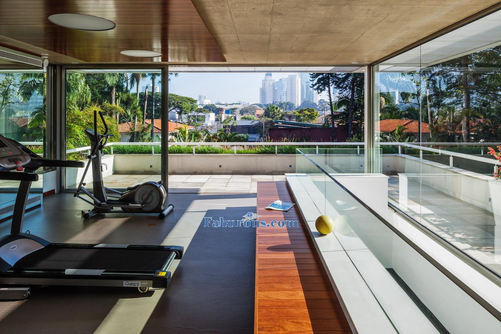 Open space brazilian modern house design Living room gym