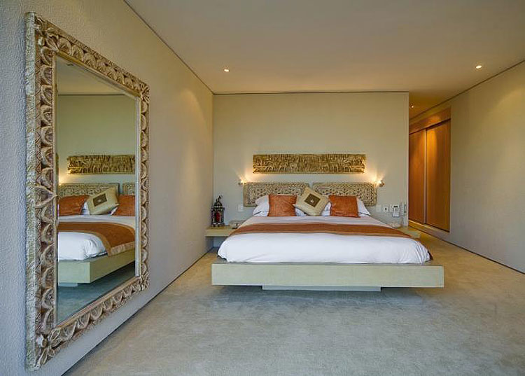 Great ideas on how to create space in a small bedroom for Large mirror for bedroom wall