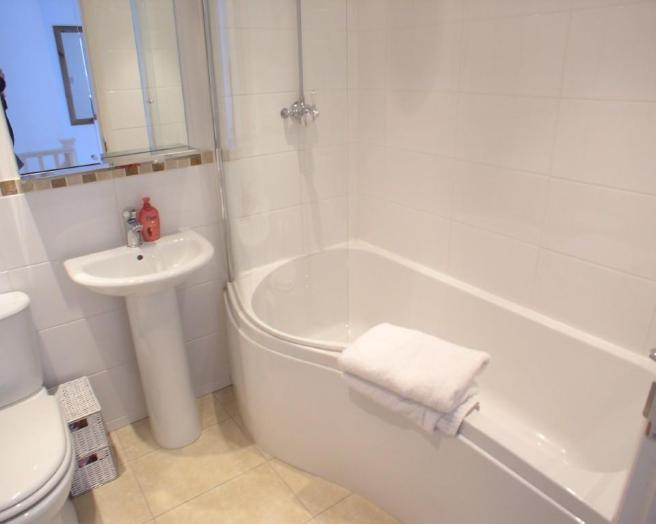 all white small bathroom design