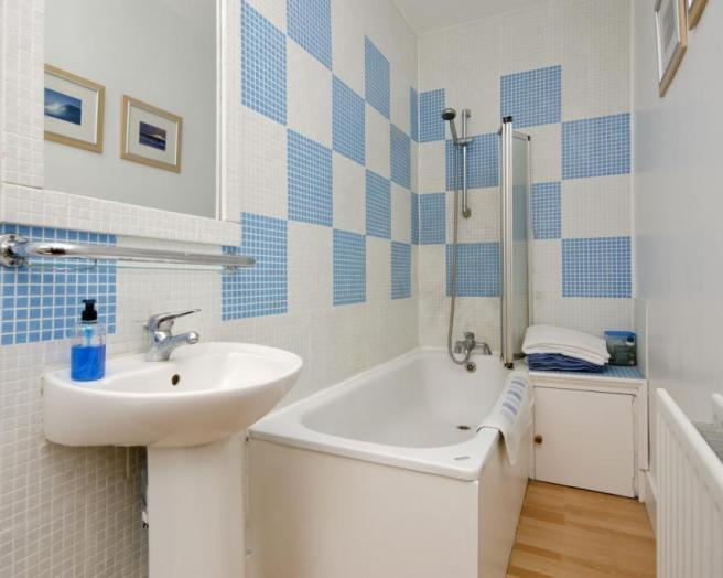 blue and white tiled wall small bathroom design