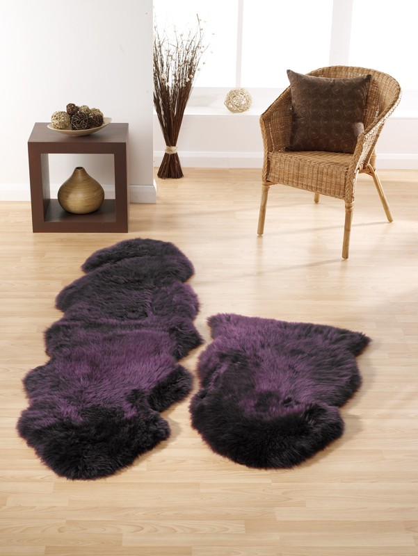 Purple Sheepskin Rugs On Wooden Floor in small living room space