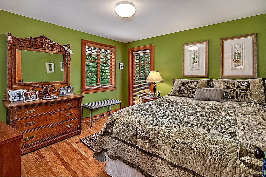 green and brown master bedroom