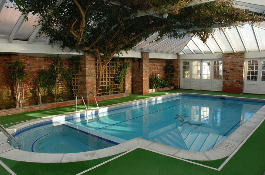 10 best indoor swimming pools designs for House design with swimming pool