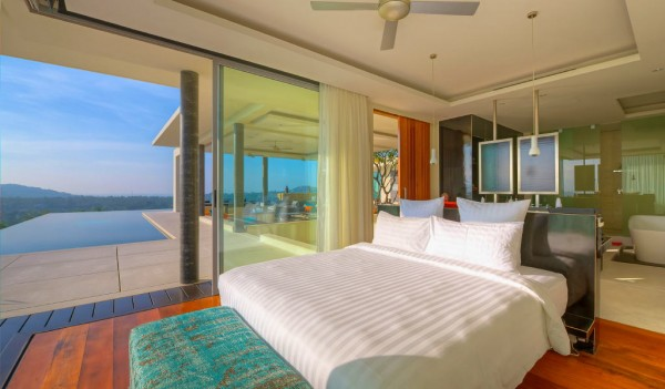 villa Bedroom with a swimming pool