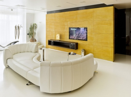 Modern-Minimalist-Apartment-Living-Room-Interior-with-Contemporary-Modern-White-Sofa-and-Wood-Textured-Yellow-TV-Wall-Unit