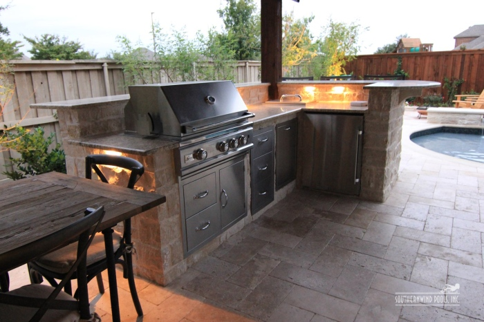 outdoor kitchen with swimming pool