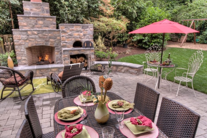 outdoor stone fire place with dining room set
