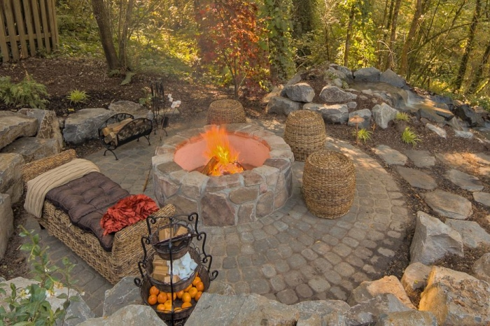 outdoor fireplace with bed on side