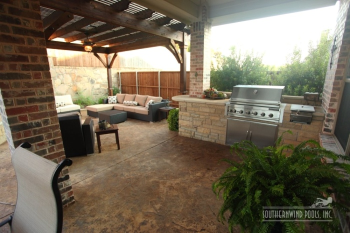 outdoor kitchen with living area