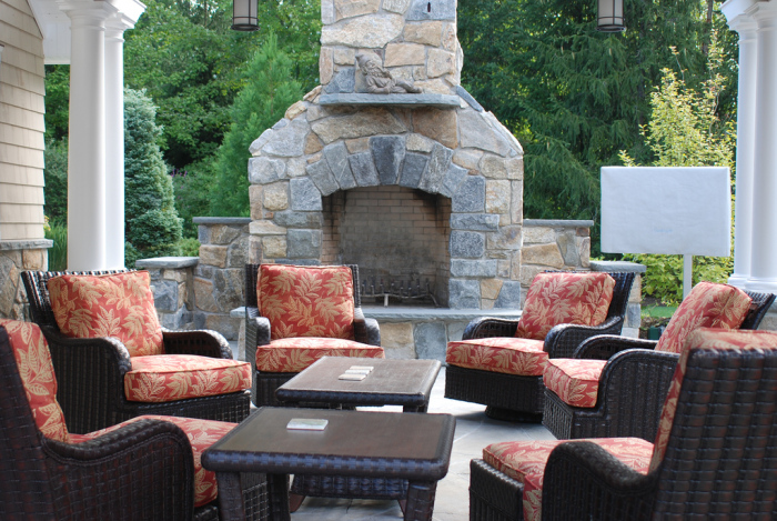 outdoor area with stone fireplace