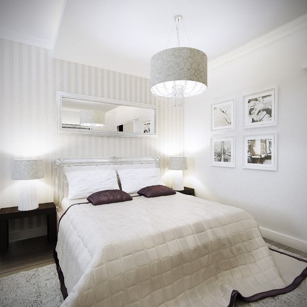 white bedroom with pictures