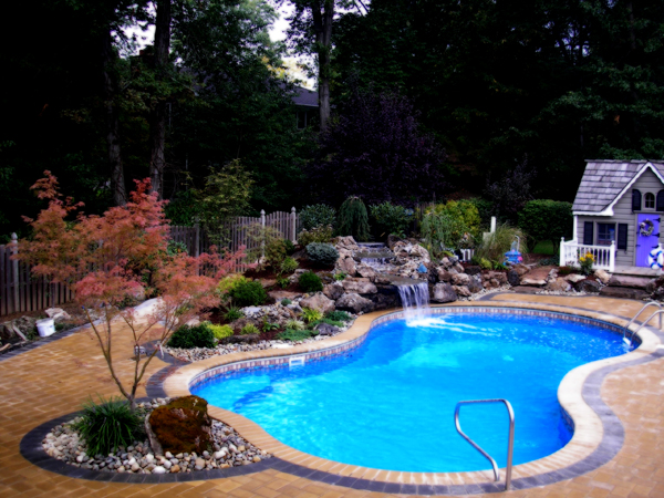 Fantastic Pool Backyard with Blue River Stone