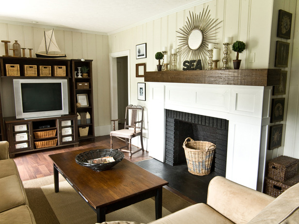 Outdated Brick Fireplace with Black and  White Painted Lumber