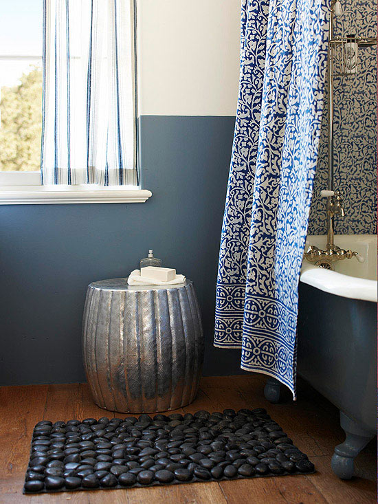 gray bathroom with printed curtain