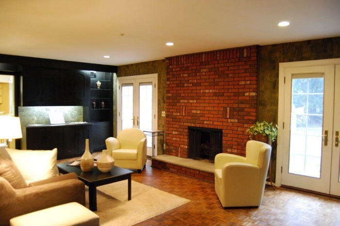 fireplace in exposed brick wall
