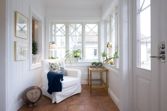 white hall way with white sofa and white walls