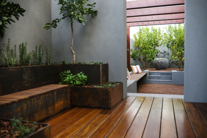 A-wooden-plank-area-of-the-garden-with-grown-plants