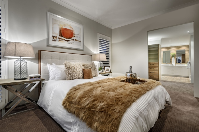 White-and-grey-bedroom-with-a-brown-fur-quilt-spread-across-the-bed