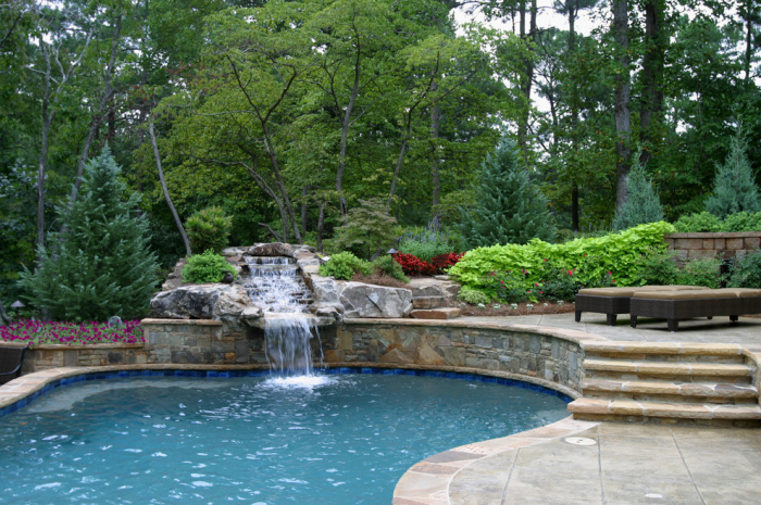 The water that comes down as steps into the pool gives it a picturesque look