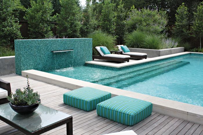 White chalk marbled tiles form the boundary of the swimming pool