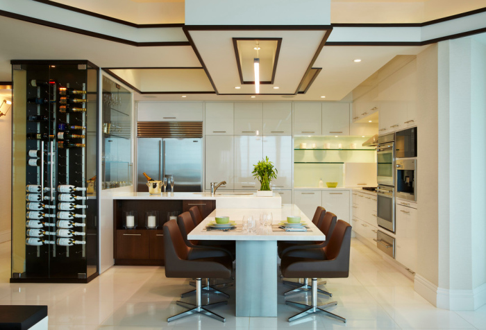 A-plush-open-kitchen-accompanied-by-an-elegant-dining-setup