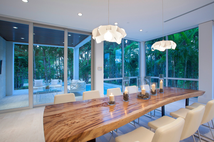 Modern-dining-room-with-a-tree-trunk-dining-table-for-12-off-white-seater-chairs-idea