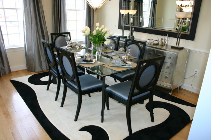 White-grey-black-and-blue-dining-room-with-the-stylish-glass-top-dining-table