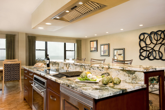 Modern-Kitchen-island-with-microwave-oven-embedded-in-the-cabinet-system