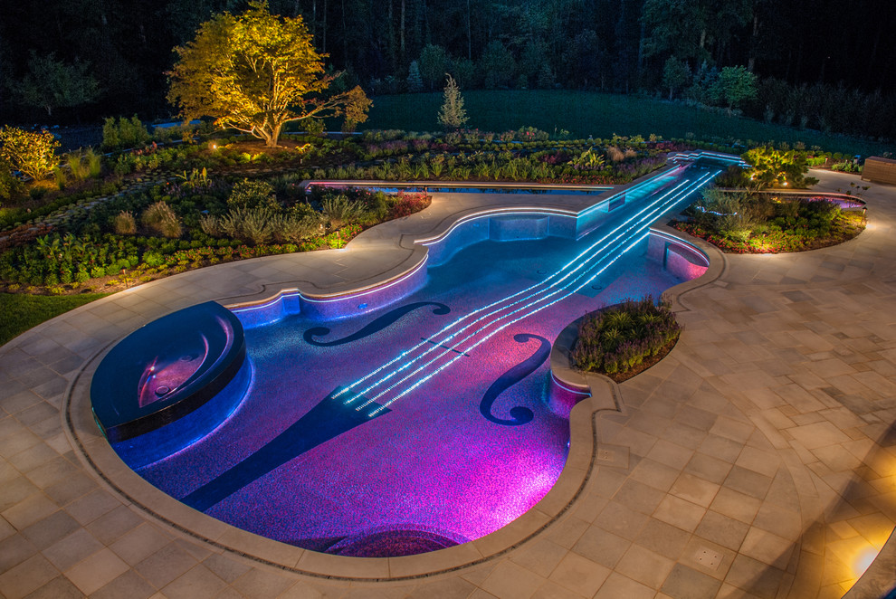 Pool Landscape Lighting Ideas Intended Reflection Of Pink And Blue Lights On Swimming Pool 10 Landscape Lighting Ideas