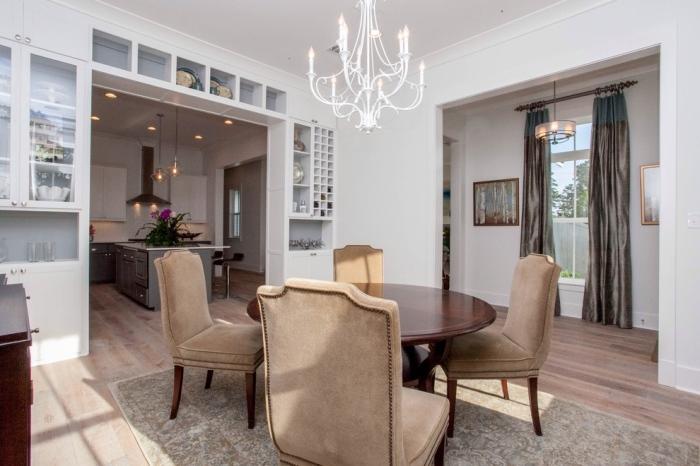 Dining chairs evoke a nice warm cozy feel amidst an elegant set-up