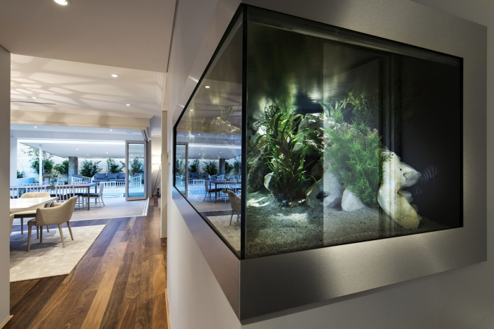 A-living-space-with-an-aquarium-like-structure-Romano-crescent-residence-with-cool-coastal-setting-in-Etesian-Australia