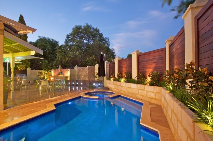 A swimming pool with beautiful fencing