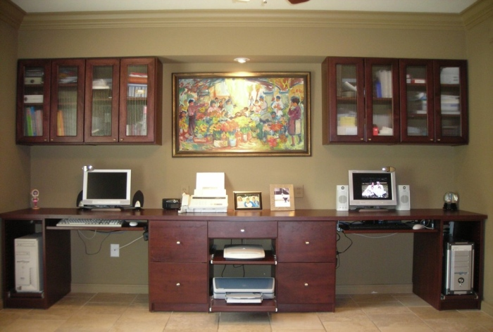 Home-office-with-Long-wooden-multiple-racks-and-drawers-table-and-sizeable-cupboards-on-the-wall