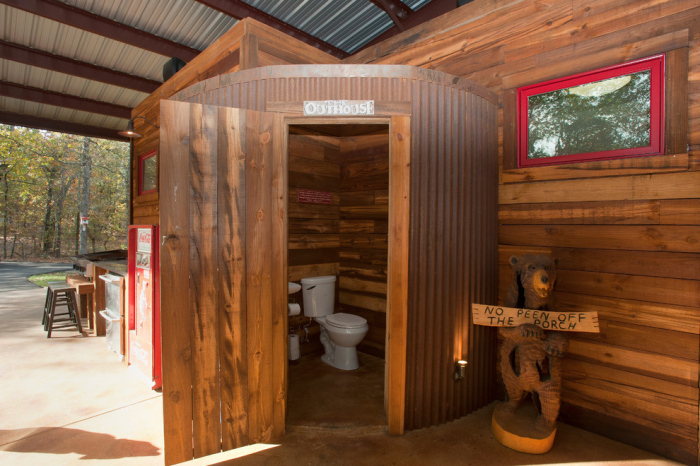 Light wood panel structure is shaped as a changing room built up