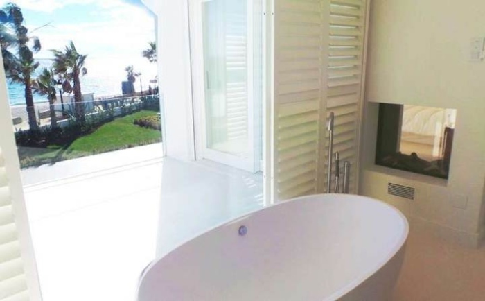 White-Bathroom-With-A-Bathtub- Beside-The-Window