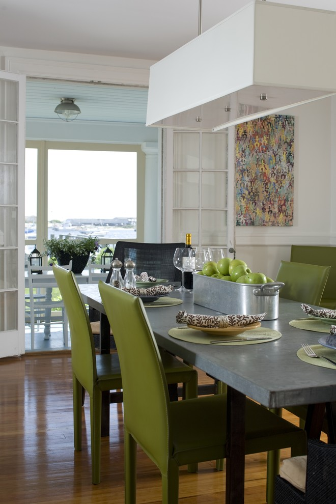 The dining table is duly accompanied by the big light moss-green chairs