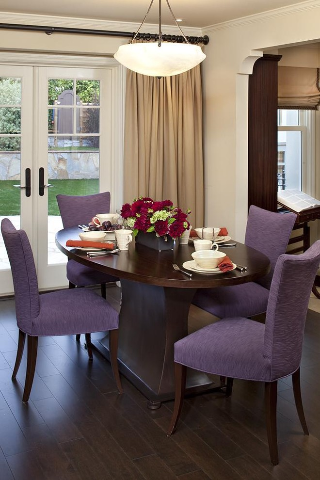 Traditional-dining-room-with-purple-covered-dining-chairs