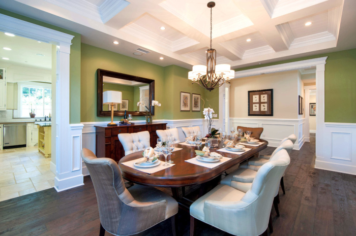Traditional-dining-room-with-Pista-green-colour-wall-and-mint-green-panel-design-idea