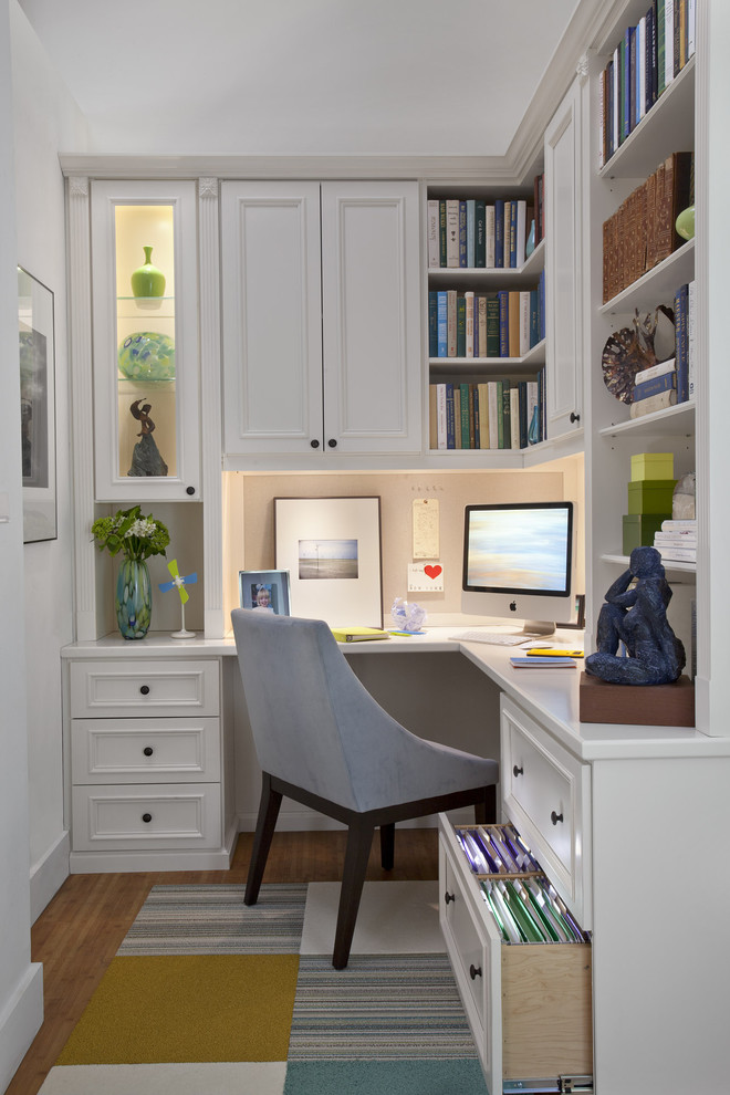White-constricted-office-space-with-bent-wooden-table-mult-drawers-cupboards-and-racks