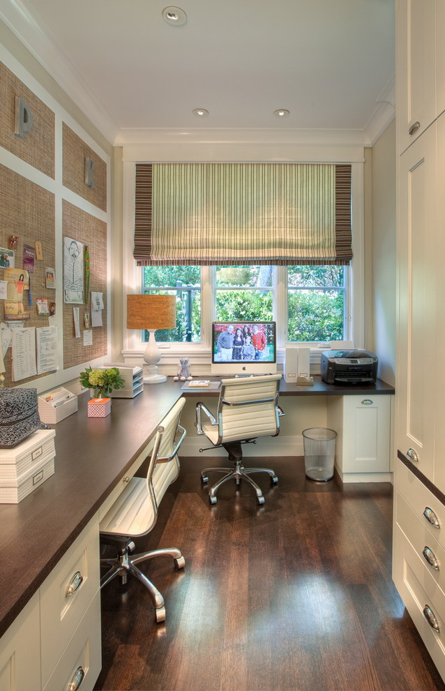 Long-rectangular-office-space-with-a-bent-elongated-table-and-huge-cupboard