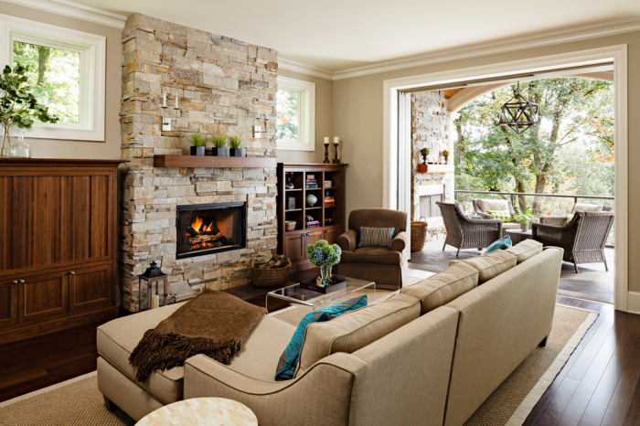 Traditional-Living-Room With Small Glass Coffee Table Next To fireplace