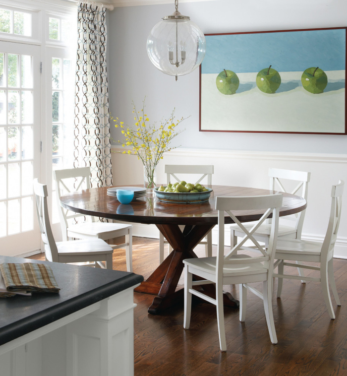 White-dining-room-with-a-round-wooden-table