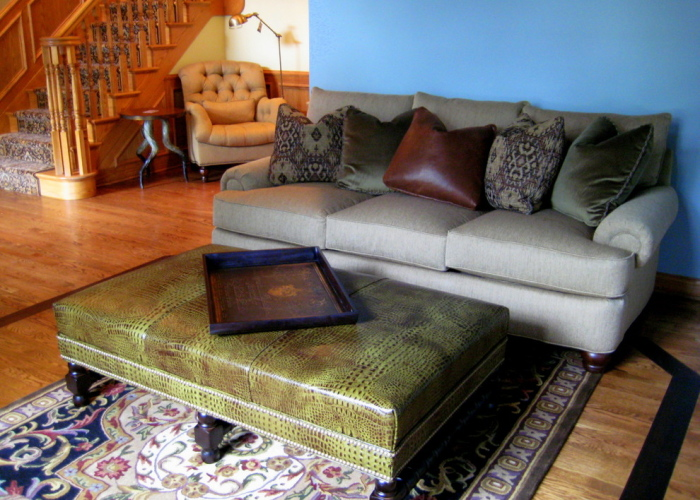 Wooden-living-room-with-a-leather-variant-and-suede-material-sofa