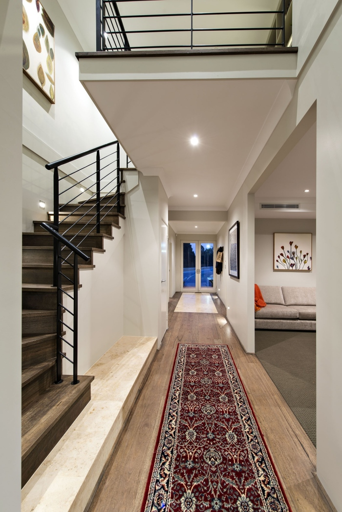 Contemporary-interior-passageway-with-a-red-carpet